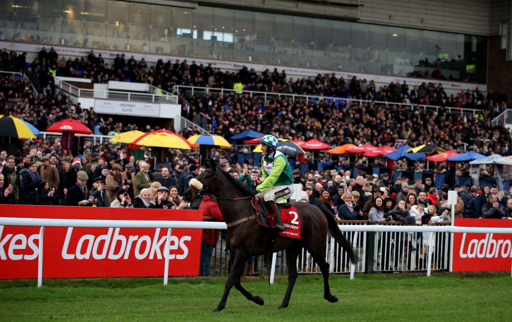 Clan Des Obeaux ridden by jockey Sam Twiston-Davies after winning the Ladbrokes King George VI Chase during day one of the Winter Festival at Kempton Park Racecourse.